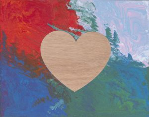 Painted wood artwork with heart cutout